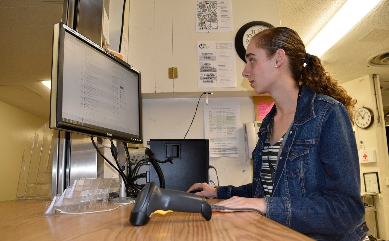 A student worker at Cal Poly uses connect2 software to manage equipment checkouts